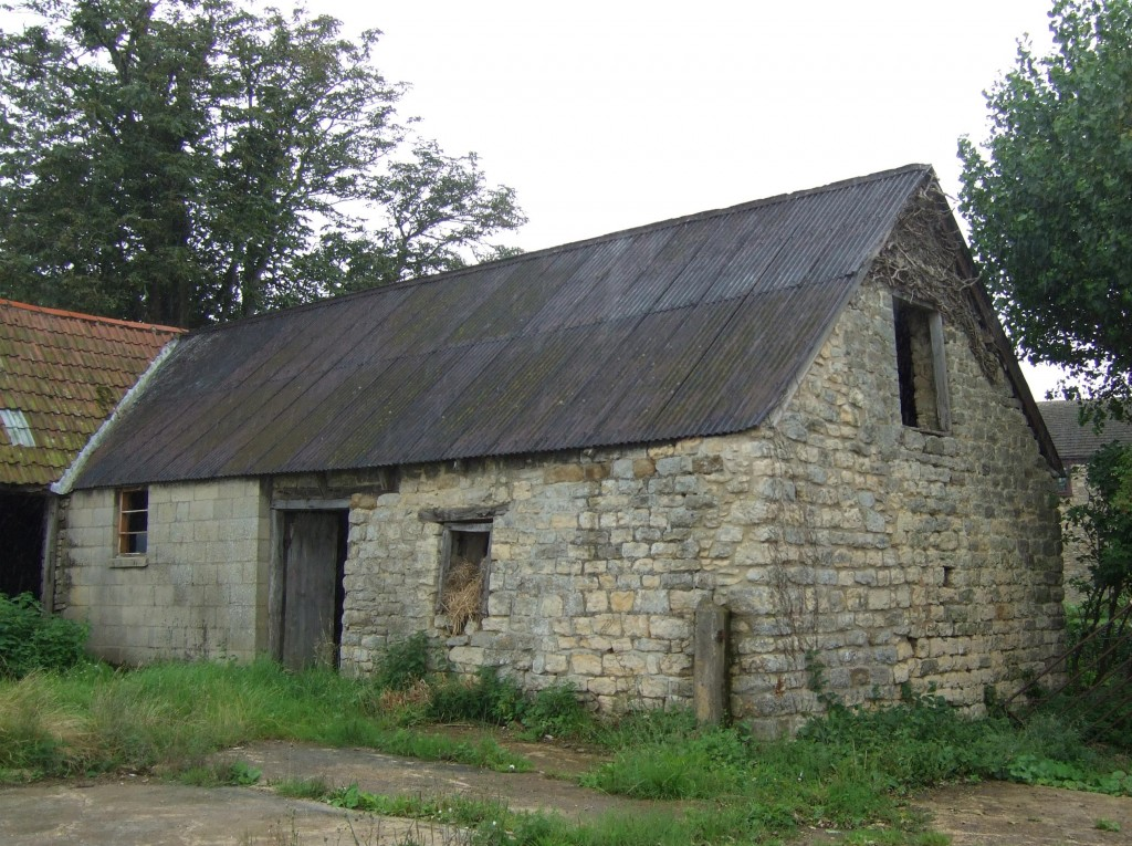 Old cider Press Barn in a dilapidated state