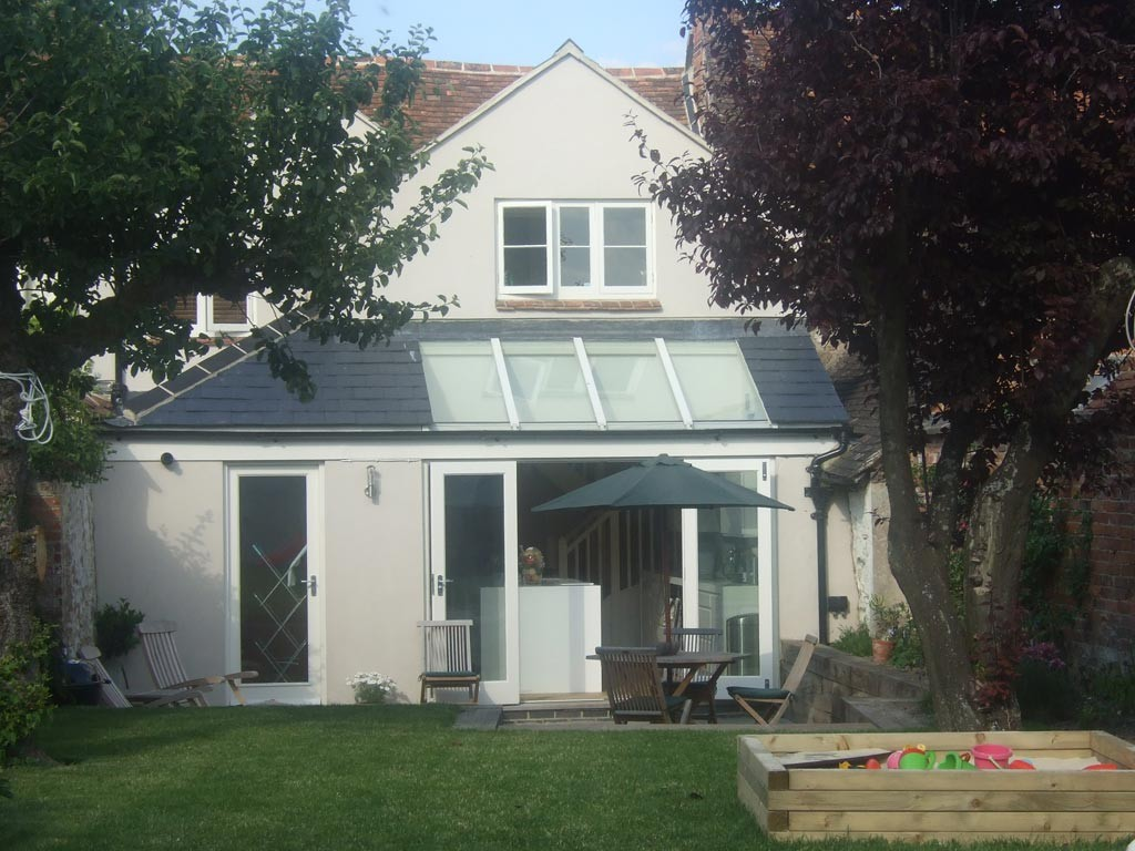 Listed cottage after conversion. Single and two storey extensions to the rear with part glazed roof