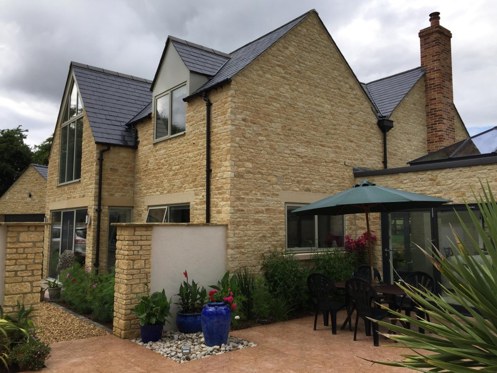 Contrast of natural stone and aluminium Polyester powder coated windows