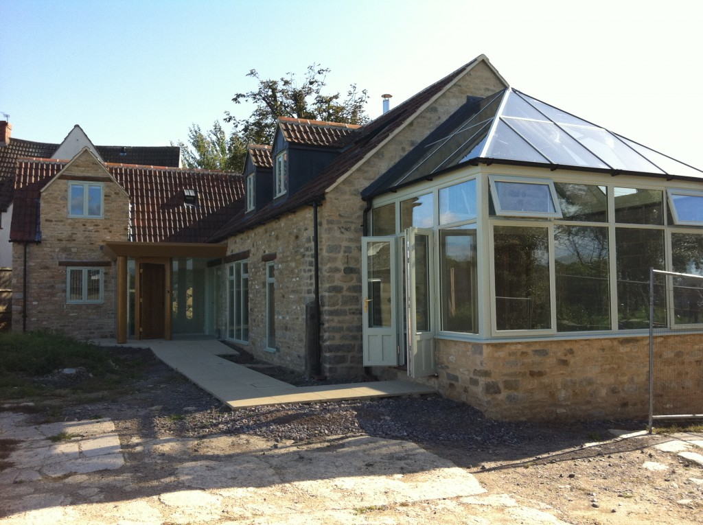 Converted barn with conservatory and converted loft