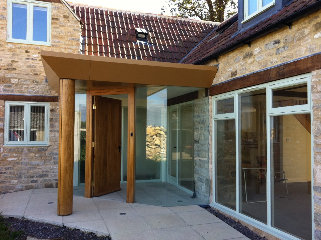 Bespoke glass to glass entrance porch