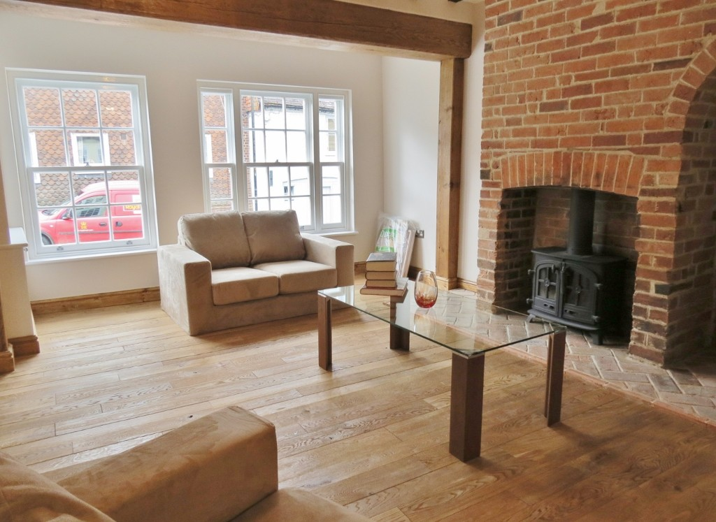 Converted living room with original renovated fireplace