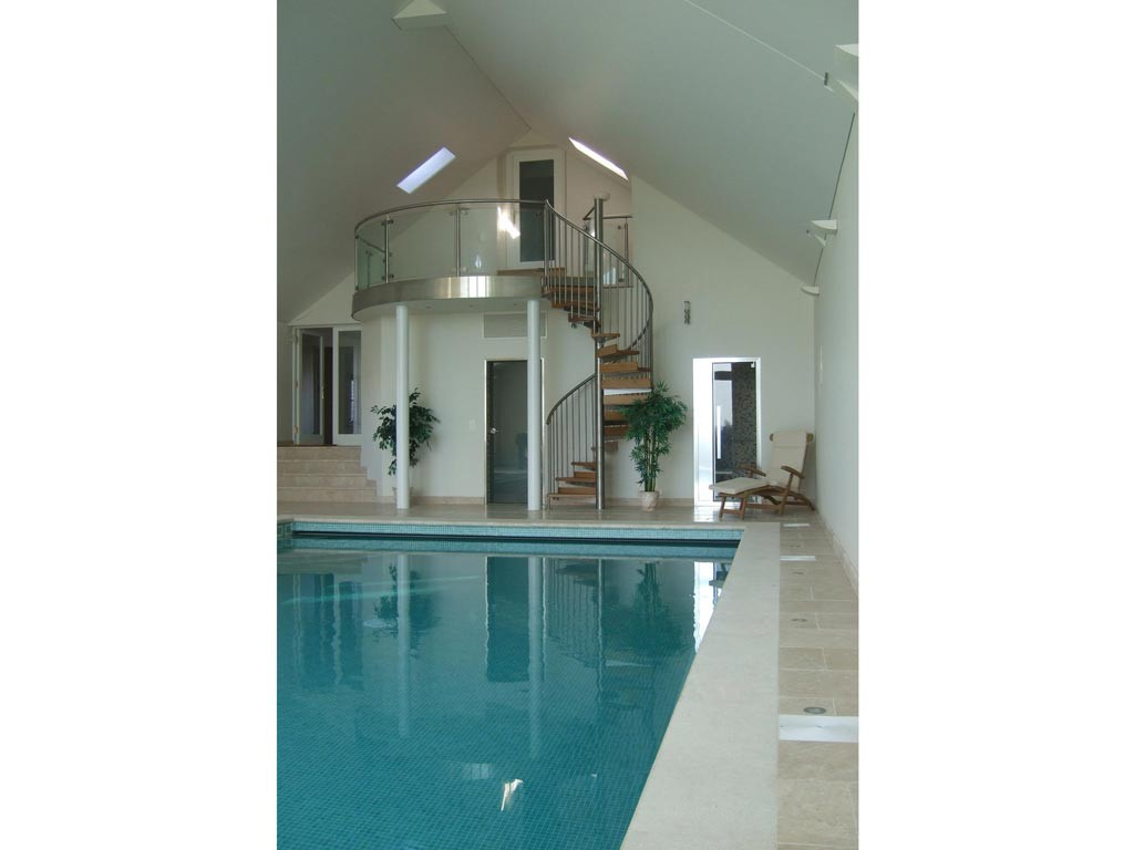 Pool extension with raised entertaining balcony and spiral stainless steel stair